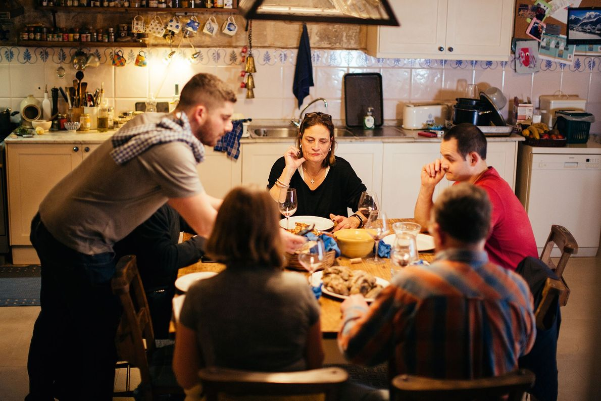 The Sammut family sit down for their evening meal