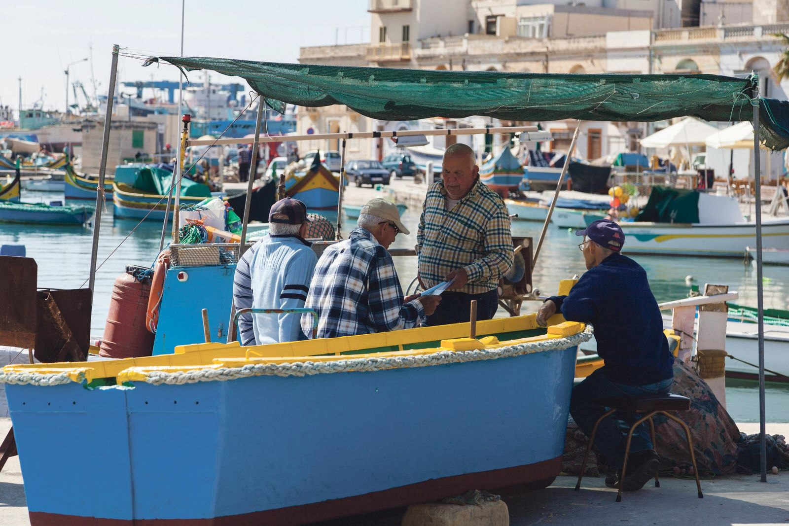 Traditional fishing boats line up in the fishing village, Marsaxlokk.
