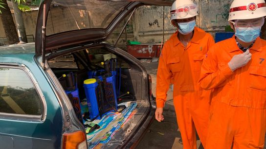 Sanitation workers in Mandalay, a hub in northern Myanmar, gear up to spray disinfectant on city ...