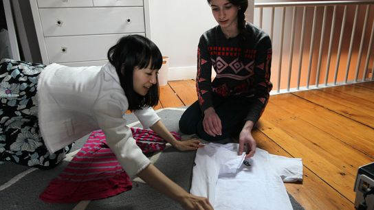 """Marie Kondo gives Otti Logan, 16, a lesson in how to fold clothes. Kondo, a """"tidying"""" ..."""