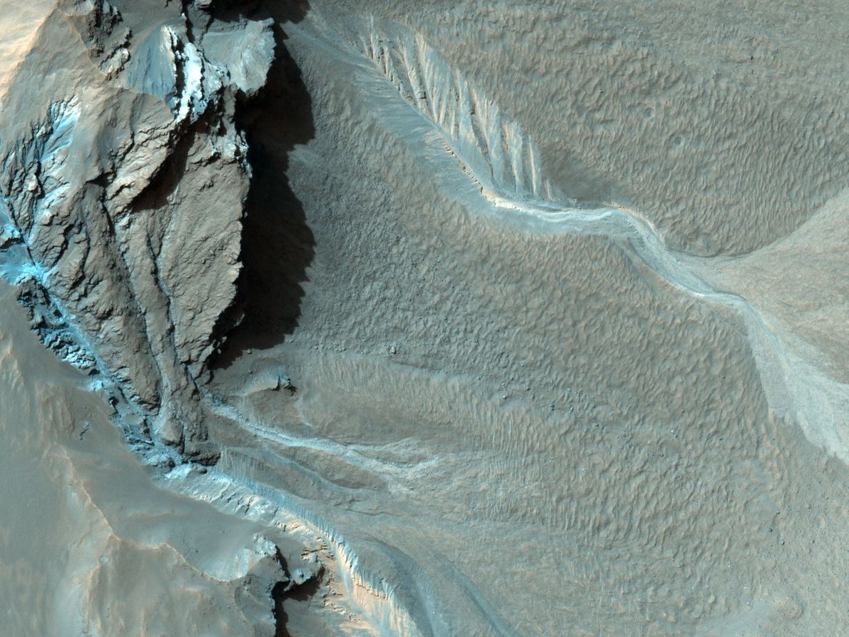 Gullies snake down the northwest rim of Hale crater. It's unclear how the gullies formed, but ...