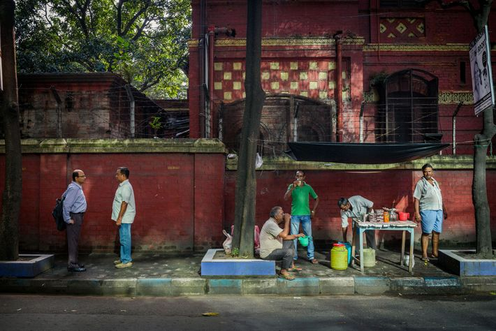 A vendor sells a drink made from sattu flour on a residential road in Kolkata, India. ...