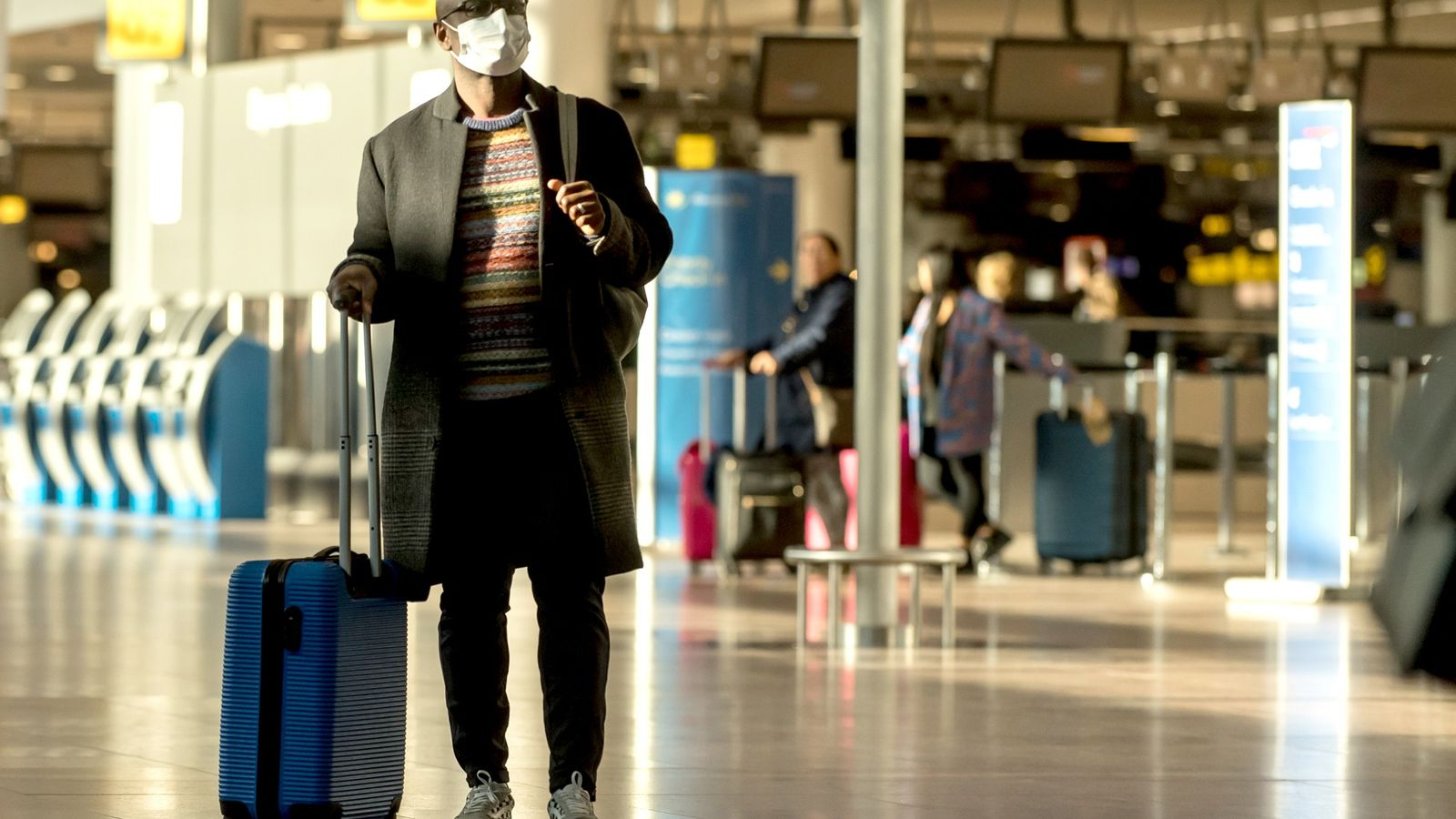 At the Brussels airport, a man wears a mask during the coronavirus outbreak.