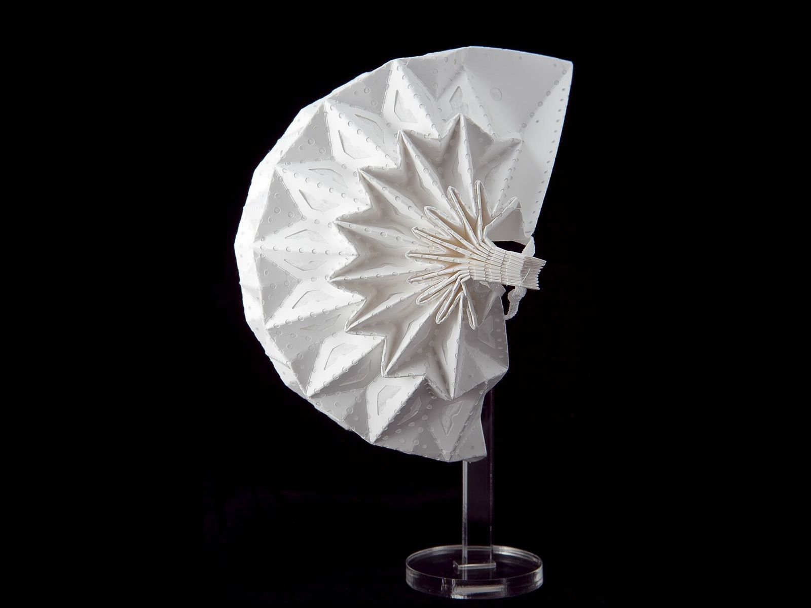 This intricately folded structure is the Airgami mask from Air99 LLC. The folding pattern imparts unique ...