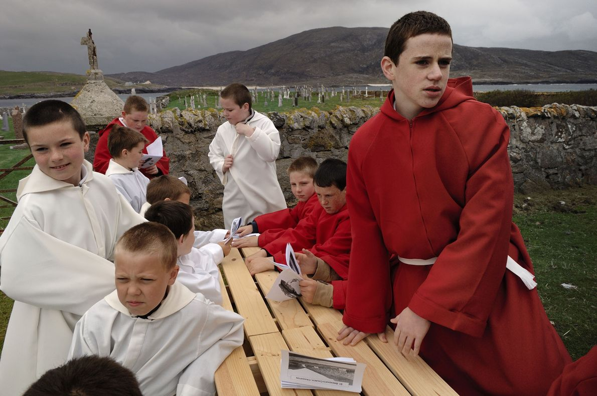 Boys gather after a mass honouring the founding of St. Brendan's church in Barra in the ...