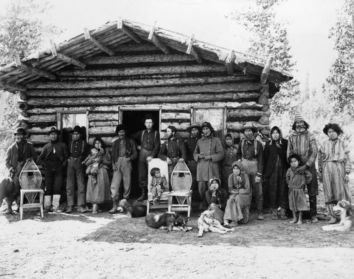 Pictured in this 1903 photo of the Davis Roadhouse, near Valdez, Alaska, are Indigenous peoples identified ...