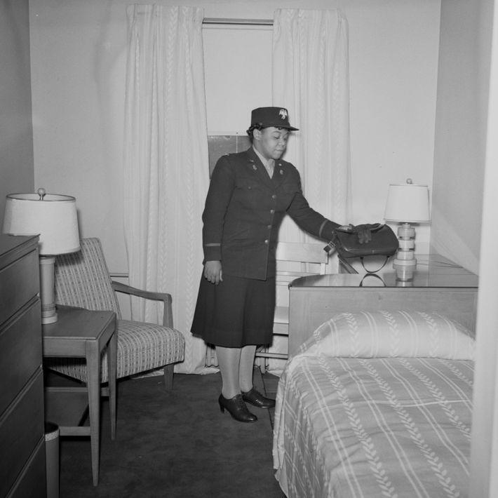 Black woman war worker in hotel room