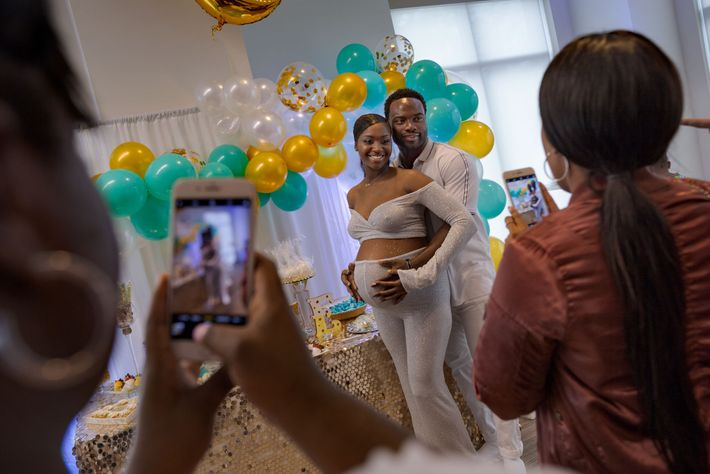 At 34 weeks pregnant, Brittany Capers, 28, and DeAndre Price, 25, enjoy their baby shower in ...