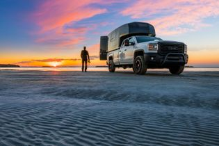 National Geographic photographer Mathieu Dupuis stands on a sandy beach near Sept-Iles in Moisie area. The ...