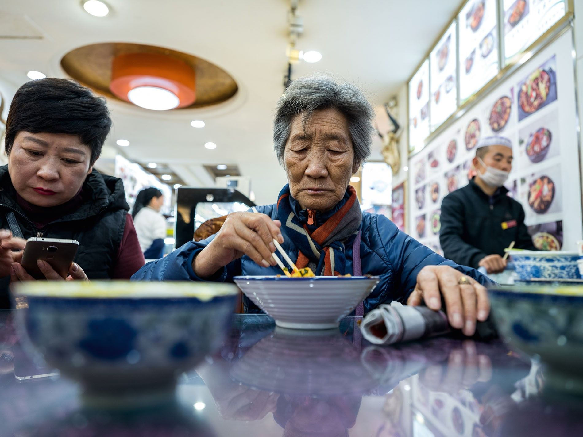 A local enjoying a fresh bowl of liangfen noodles, Ma Zhong Snack Centre.