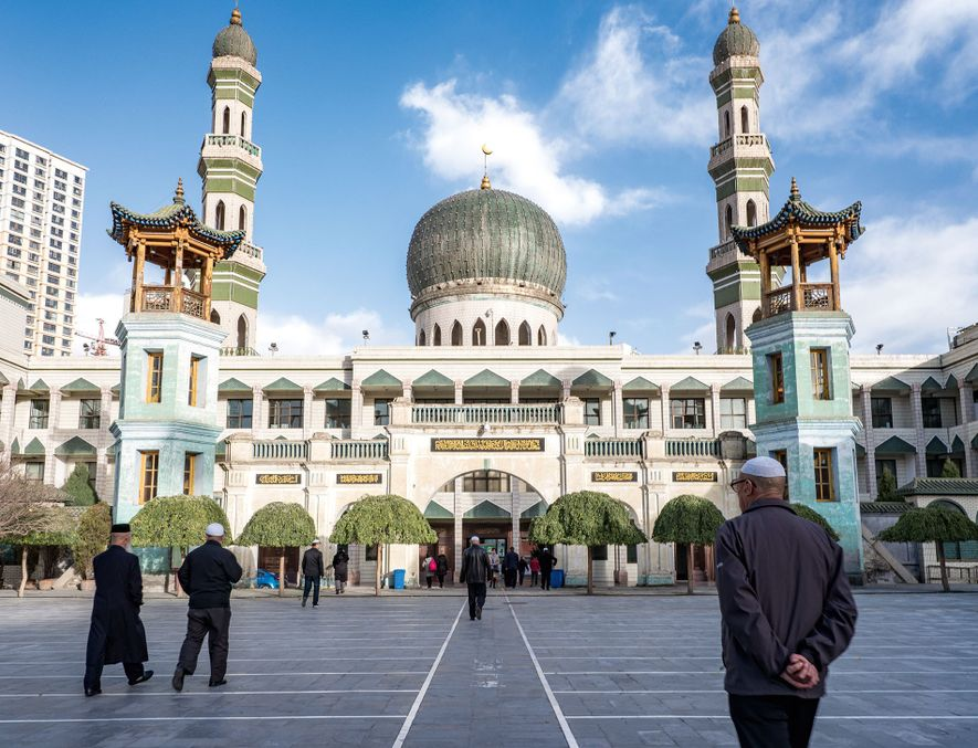 Worshippers leave the Dongguan Grand Mosque after prayers. Dongguan Grand Mosque in Xining is the biggest ...