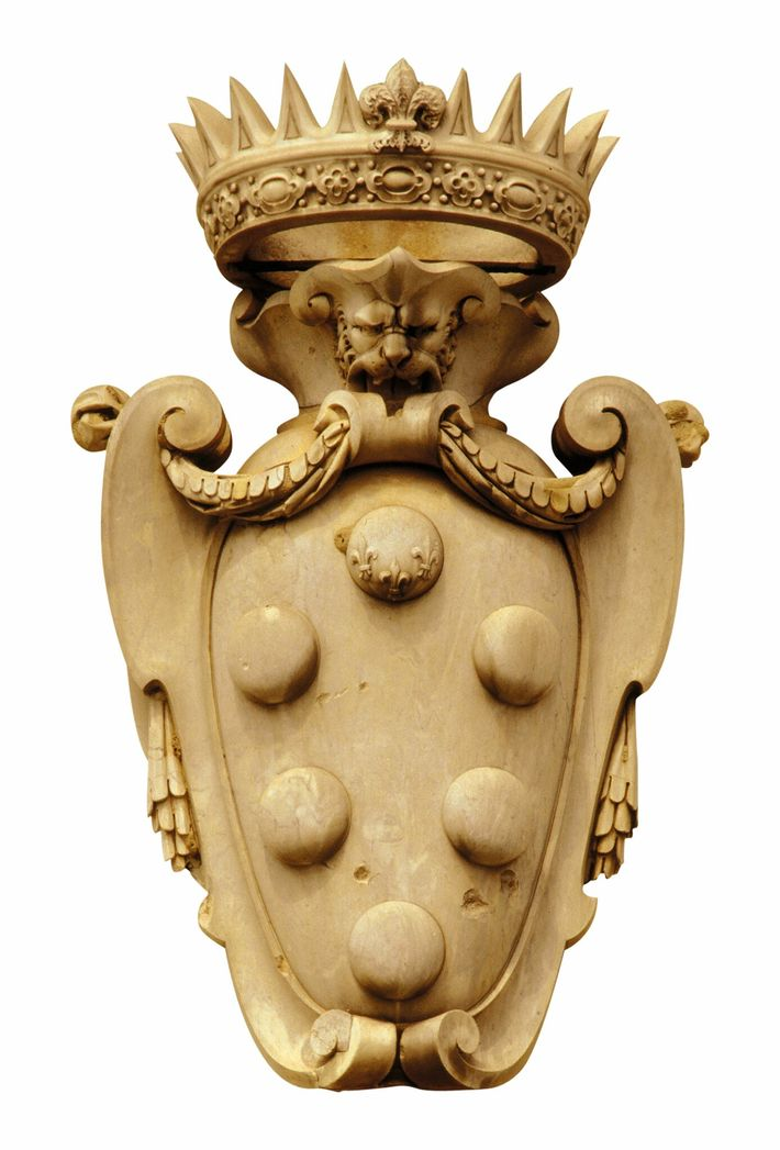 The Medici coat of arms can be seen all over the buildings of Florence. The six ...