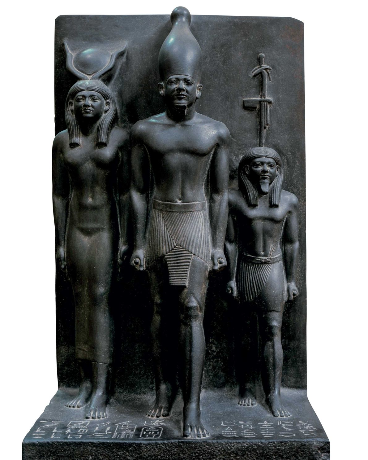 Menkaure stands in the centre and holds two scrolls in this piece at the Egyptian Museum, ...