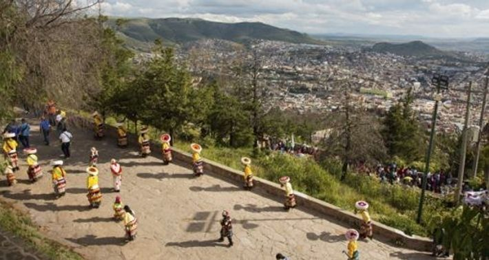 A procession makes its way to Capilla de la Virgen del Patrocinio, up a hill overlooking ...