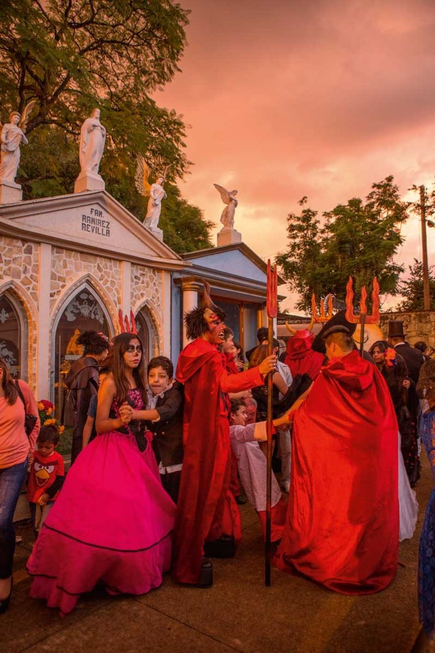 Cemeteries and mausoleums form much of the focus of those observing Day of the Dead, in ...