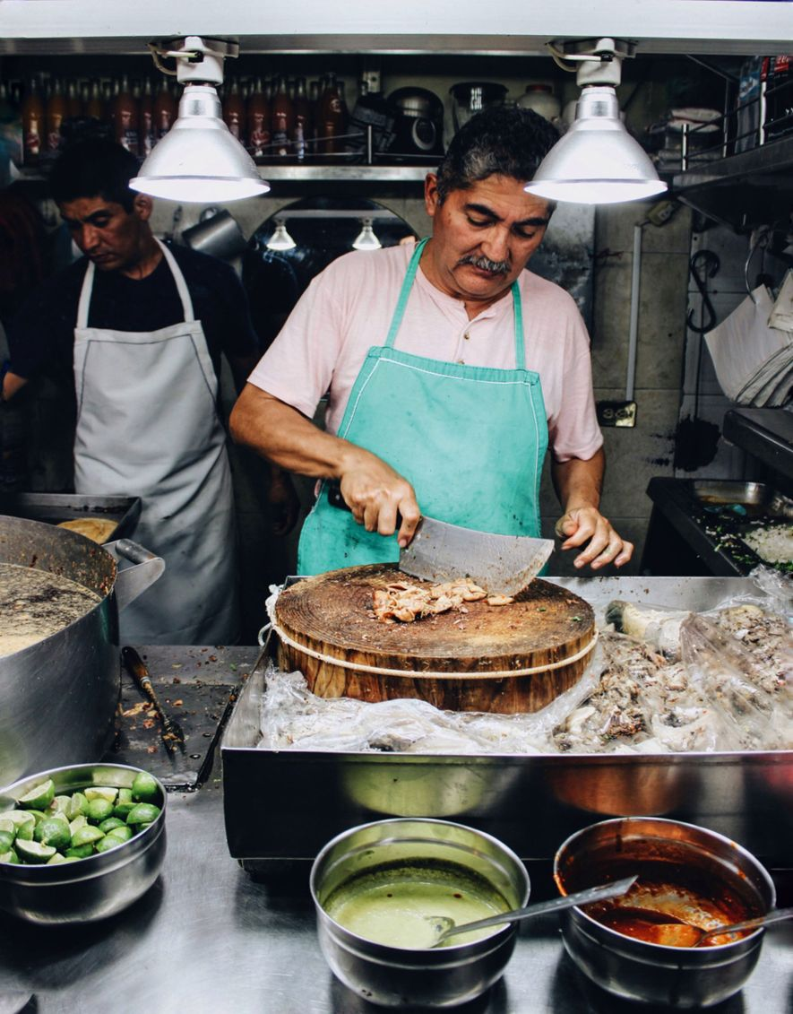 Tacos being prepared at Taquería Los Cocuyos in Mexico City