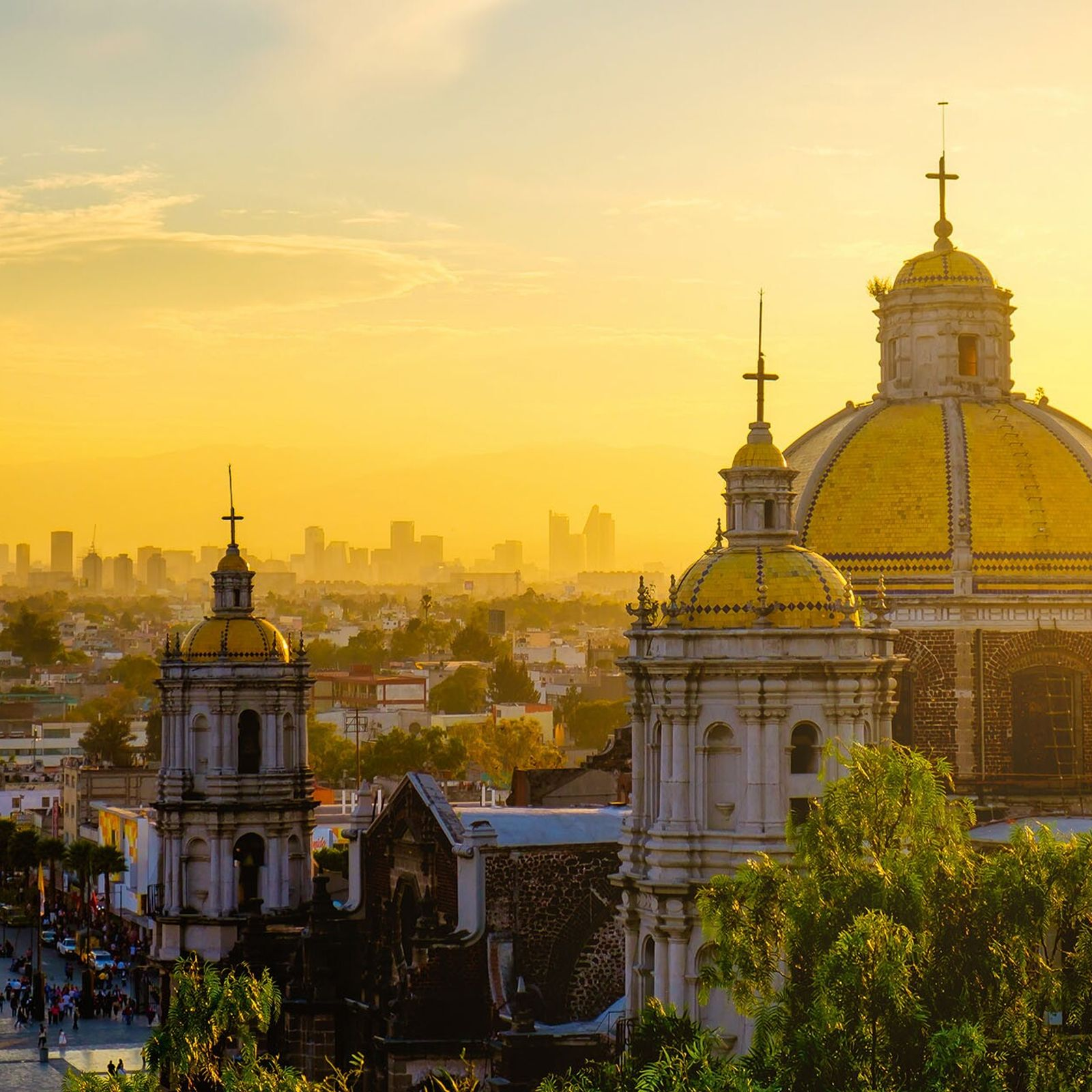 Sunset at the Basilica of Guadalupe, with Mexico City's skyline beyond.
