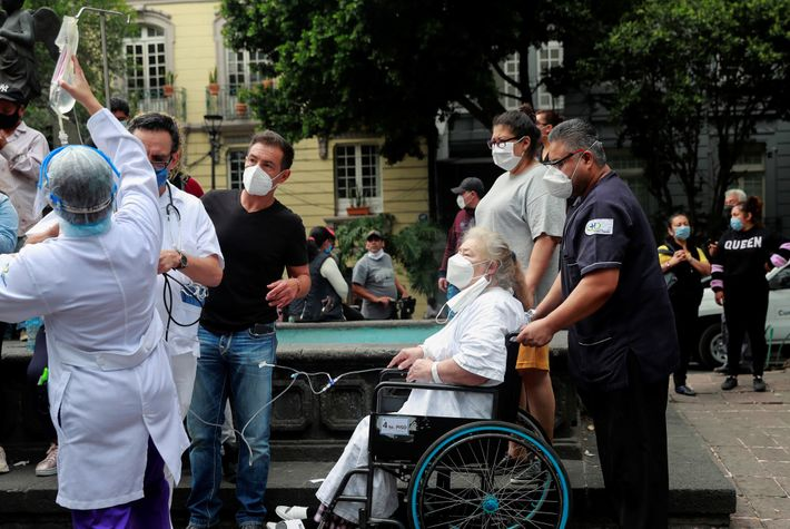 Patients and medical staff are seen outside a hospital in Mexico City after the earthquake. Fears ...