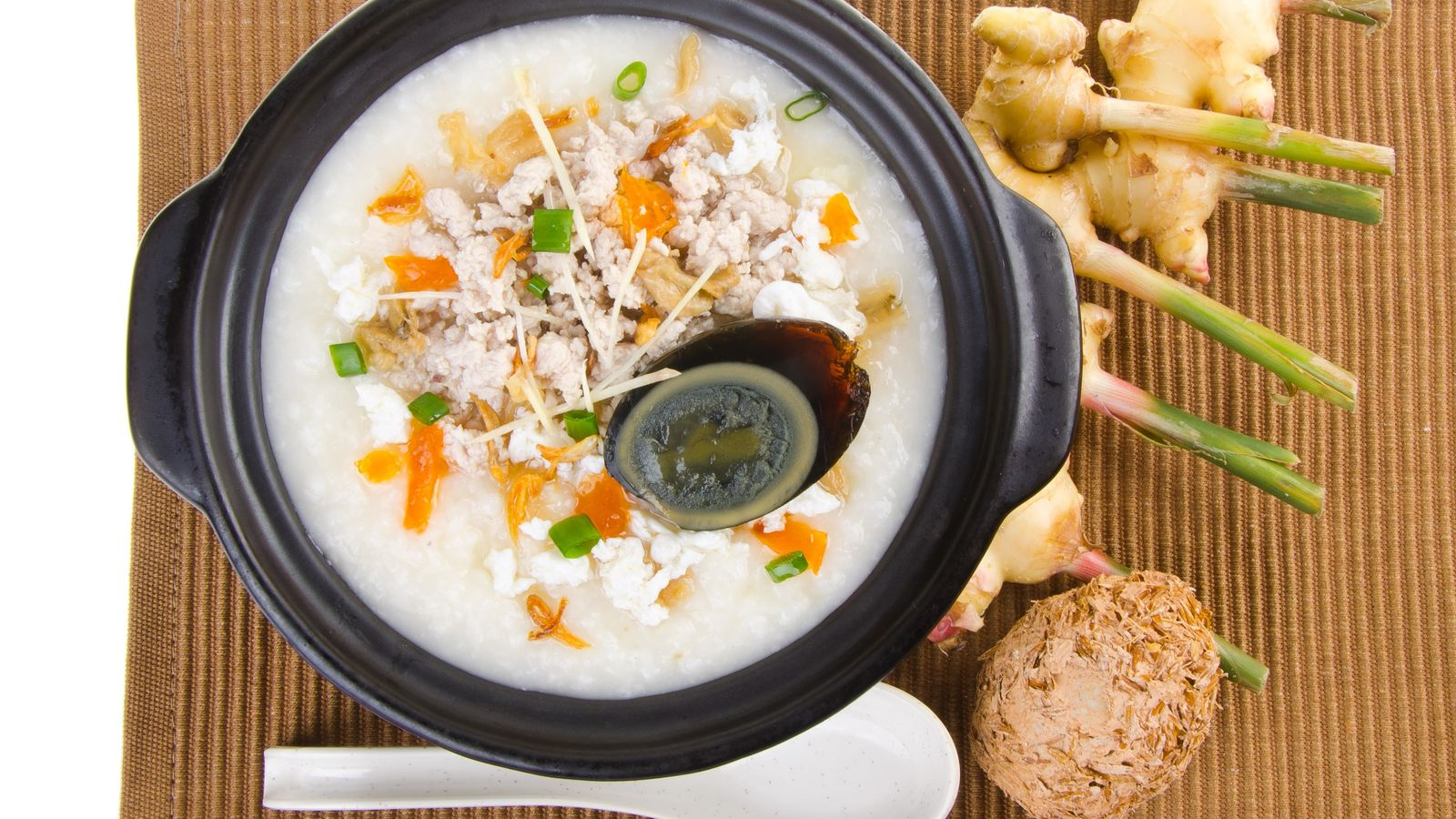 See anything you like? A congee (porridge) made with pork, vegetables – and a 'century egg'. A common ...