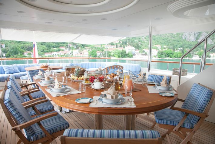 Breakfast aboard JO I superyacht with the Bay of Kotor, Montenegro, as a dramatic backdrop. The ...