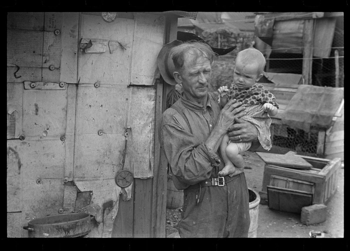 Ex-farmer and child, now on W.P.A. (Work Projects Administration), central Ohio. August 1938.