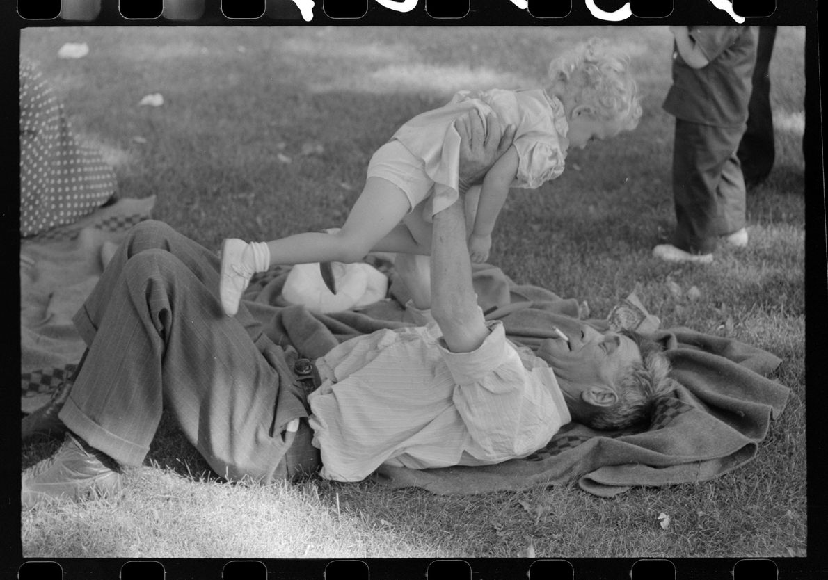 Farmer with his granddaughter at picnic on Fourth of July. Vale, Oregon. July 1941.