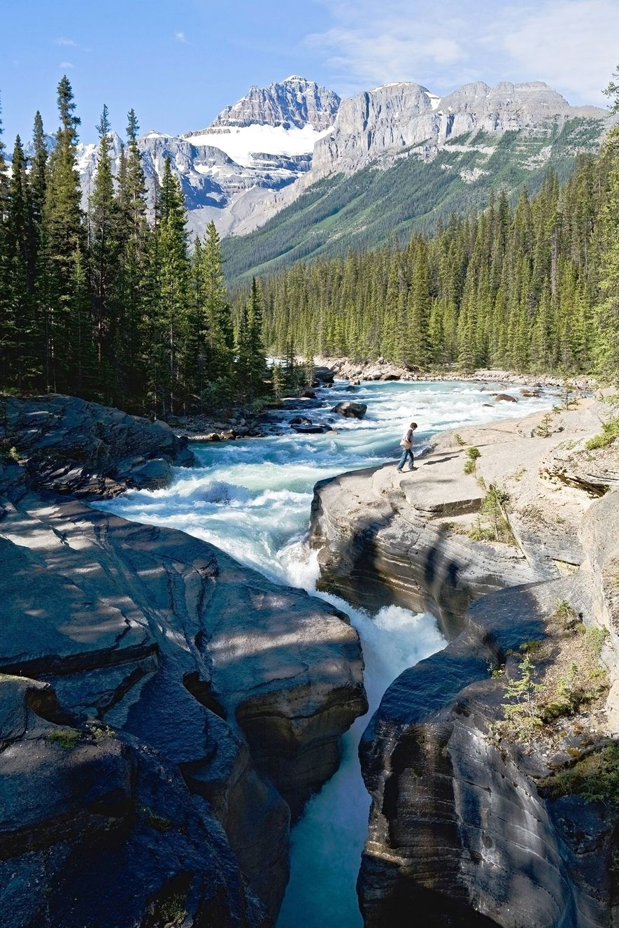 The Mistaya River rushes through the Mistaya Canyon in Alberta, Canada.
