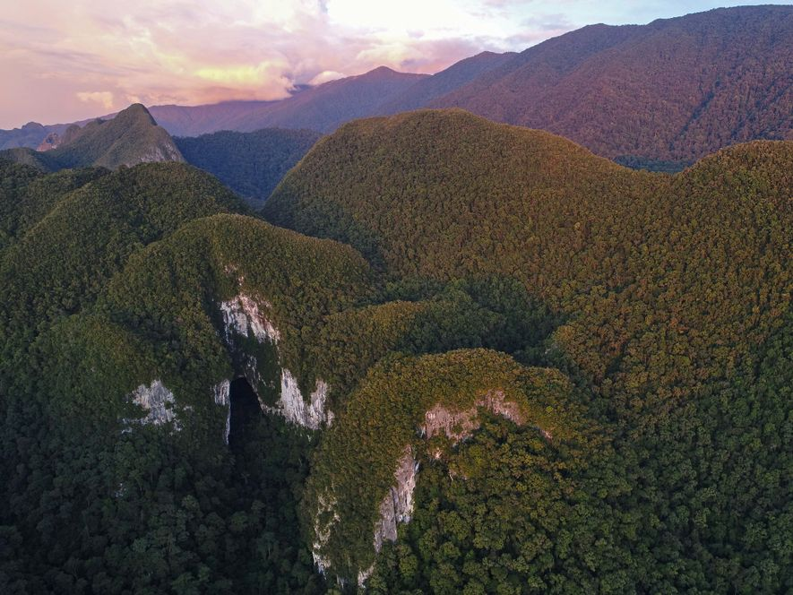 Gunung Mulu National Park, located in Malaysia's Sarawak state on the island of Borneo, is a UNESCO World Heritage site. Below a rolling green carpet of rainforest, its limestone is riddled with some of the planet's most extensive cave systems.