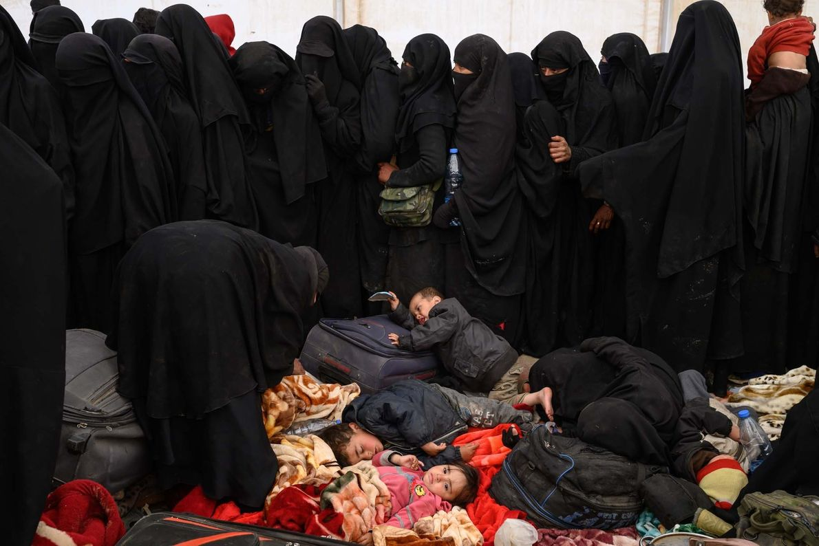Women and children relatives, who by and large expressed unwavering support for the Islamic State, wait ...