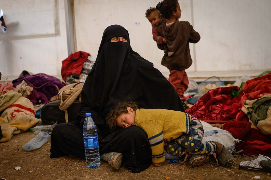 Mothers look after their children following their arrival at the al-Hol refugee camp in northern Syria.