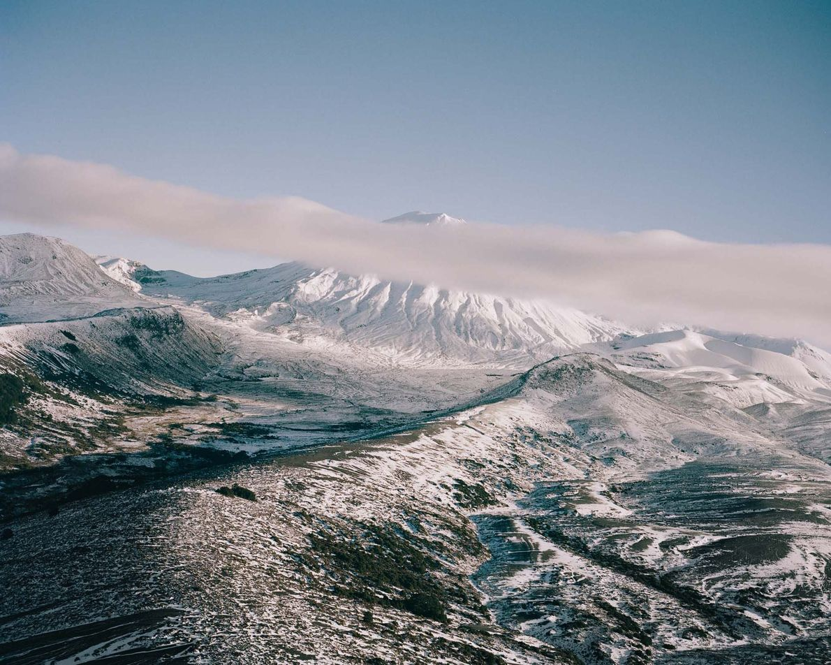Cloud-shrouded Ngauruhoe—mythical Mount Doom in Peter Jackson's The Lord of the Rings—is one of the sacred ...