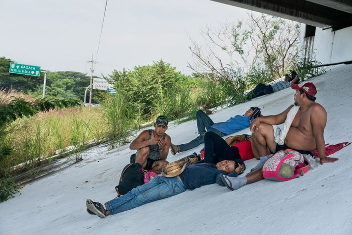 Central Americans traveling on the first migrant caravan rest under a highway overpass in Oaxaca, Mexico.