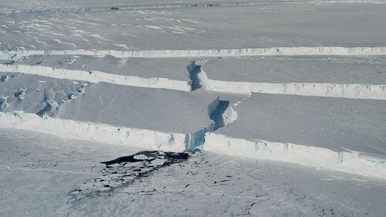 Curving ice canyons mark the edge of the new iceberg, dubbed B-46, as it breaks off ...