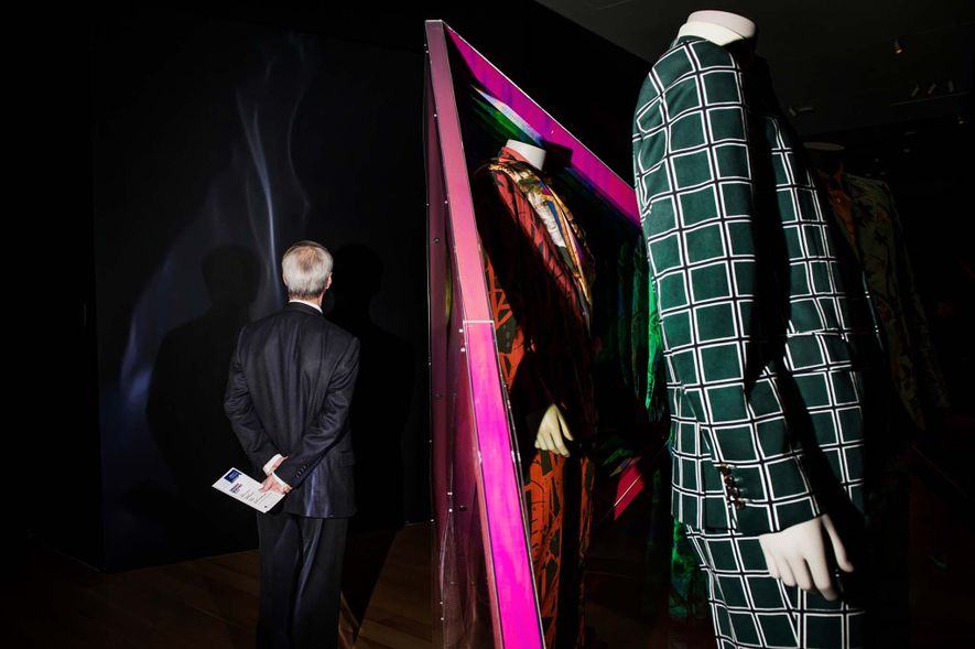"Visitors walk through what's billed as ""a century of haute couture and ready-to-wear fashion that has ..."