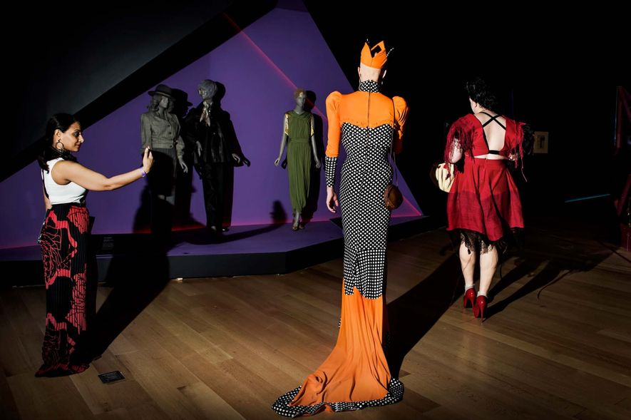 Spectators get an early look at the exhibition, which honors designers and influencers who challenged the ...