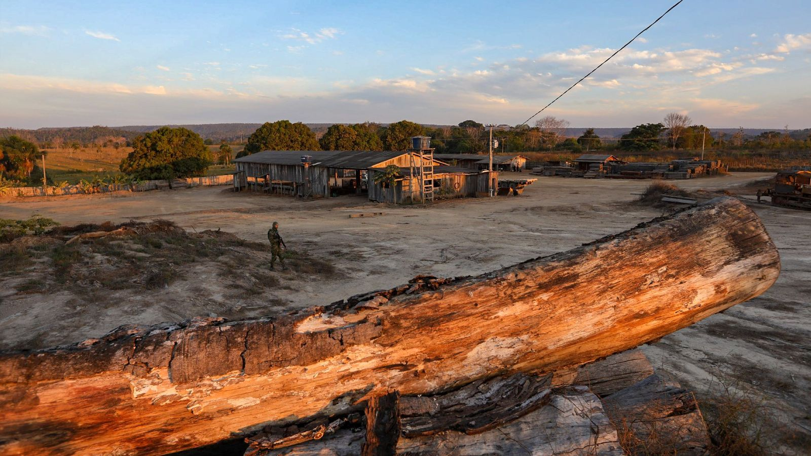 An officer from IBAMA, Brazil's environment protection agency, stands vigil at a sawmill outside Boa Vista ...