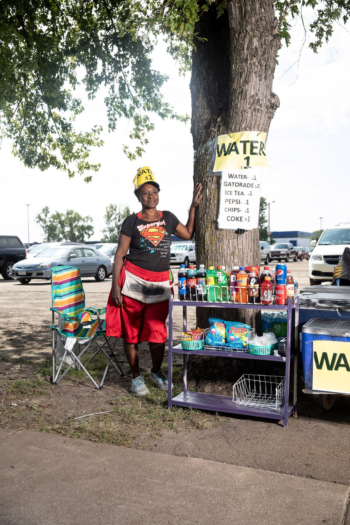 Annice Miller sells refreshing drinks on a hot day outside the entrance to the Minnesota State ...