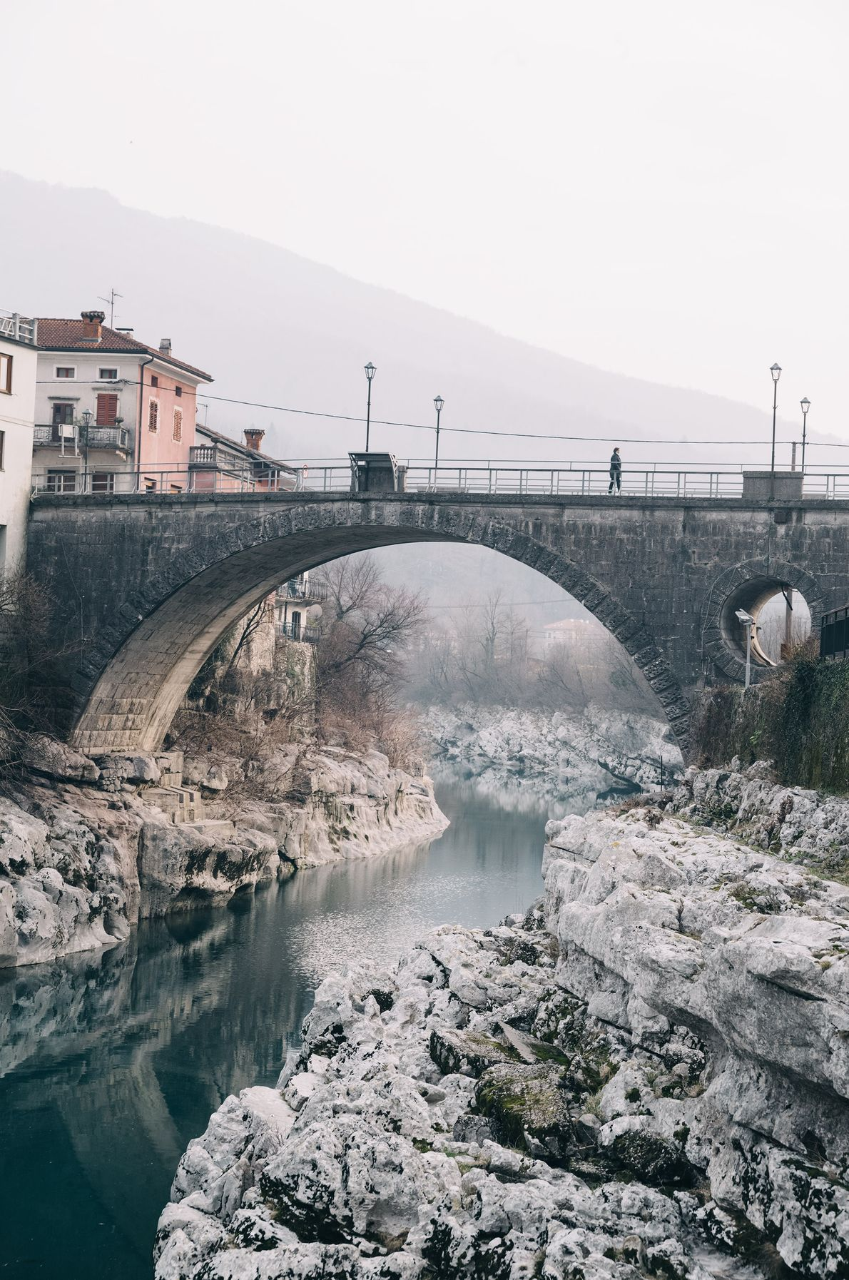 A decades-old stone bridge connects visitors to the municipality of Kanal ob Soči, which celebrates Shrovetide ...