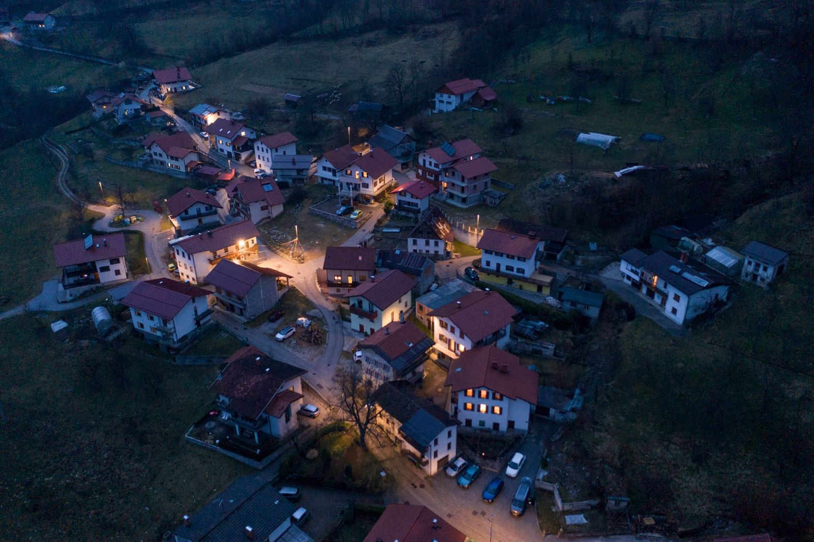 The village of Drežniške Ravne is aglow as night falls on Shrovetide. Like most villages in ...