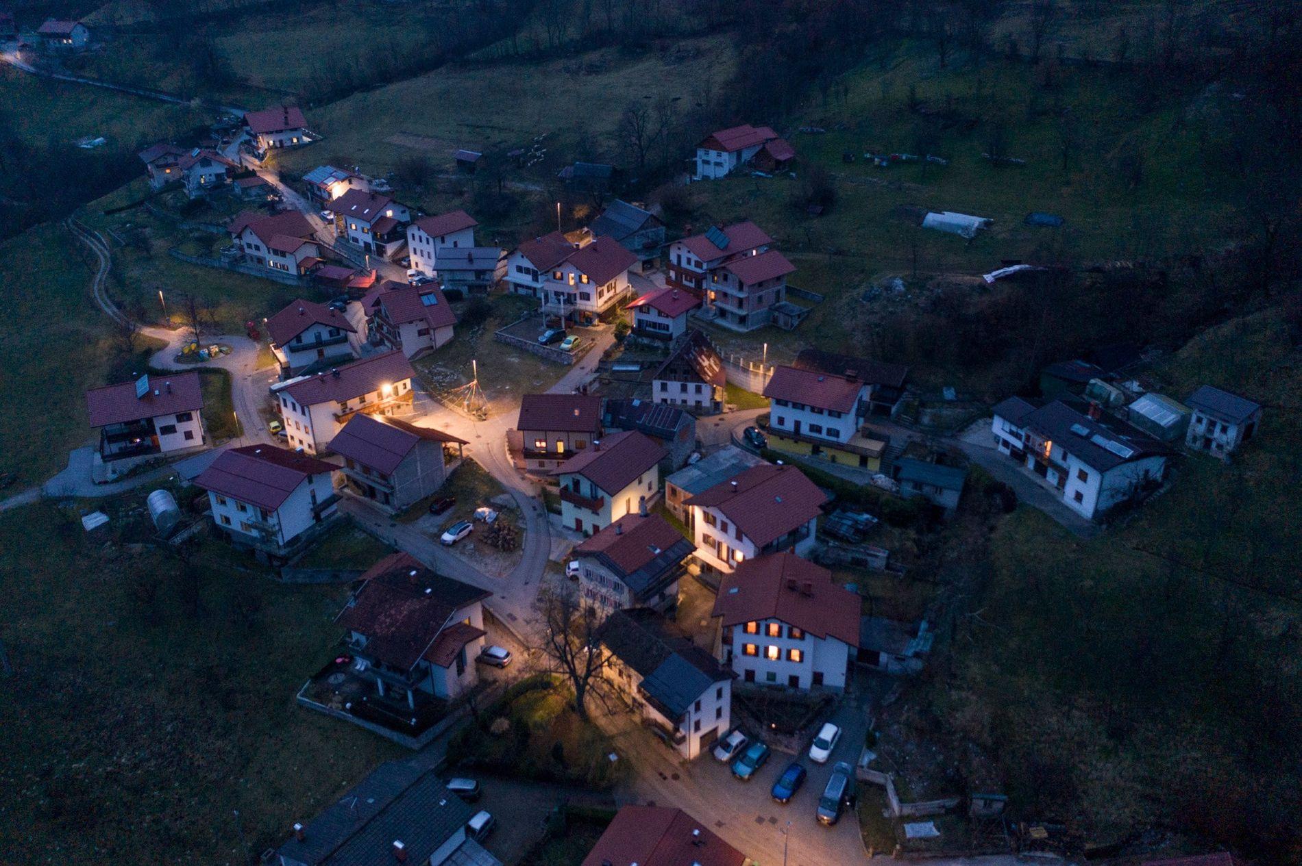 The village of Drežniške Ravne is aglow as night falls on Shrovetide. Like most villages in ...