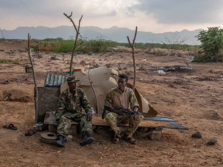 Coast guard officers sit in the yard of the run-down and underresourced station in Ceel Shiikh. ...