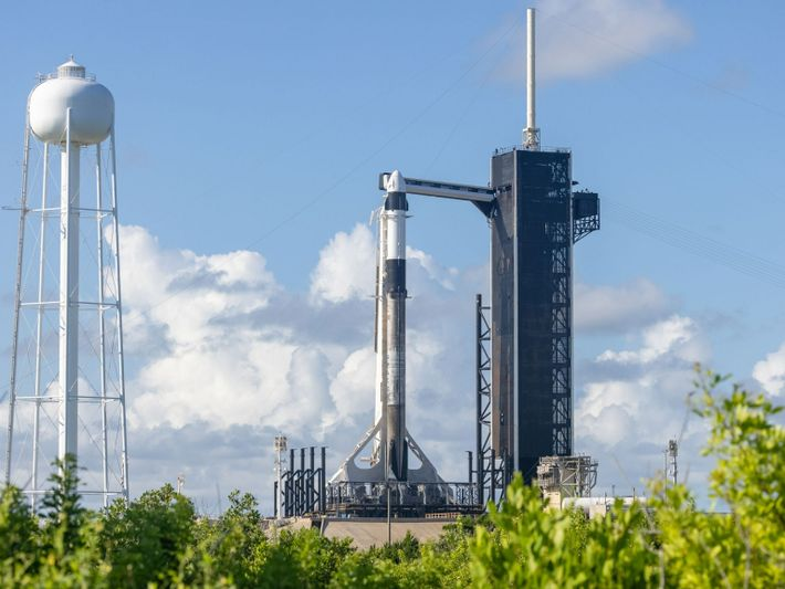 """A SpaceX Falcon 9 rocket with the Crew Dragon """"Resilience"""" sits on historic Launch Pad 39A ..."""