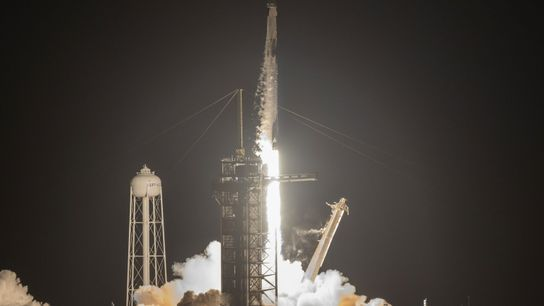 A SpaceX Falcon 9 rocket launches with the Inspiration4 mission as night settles over NASA's Kennedy ...