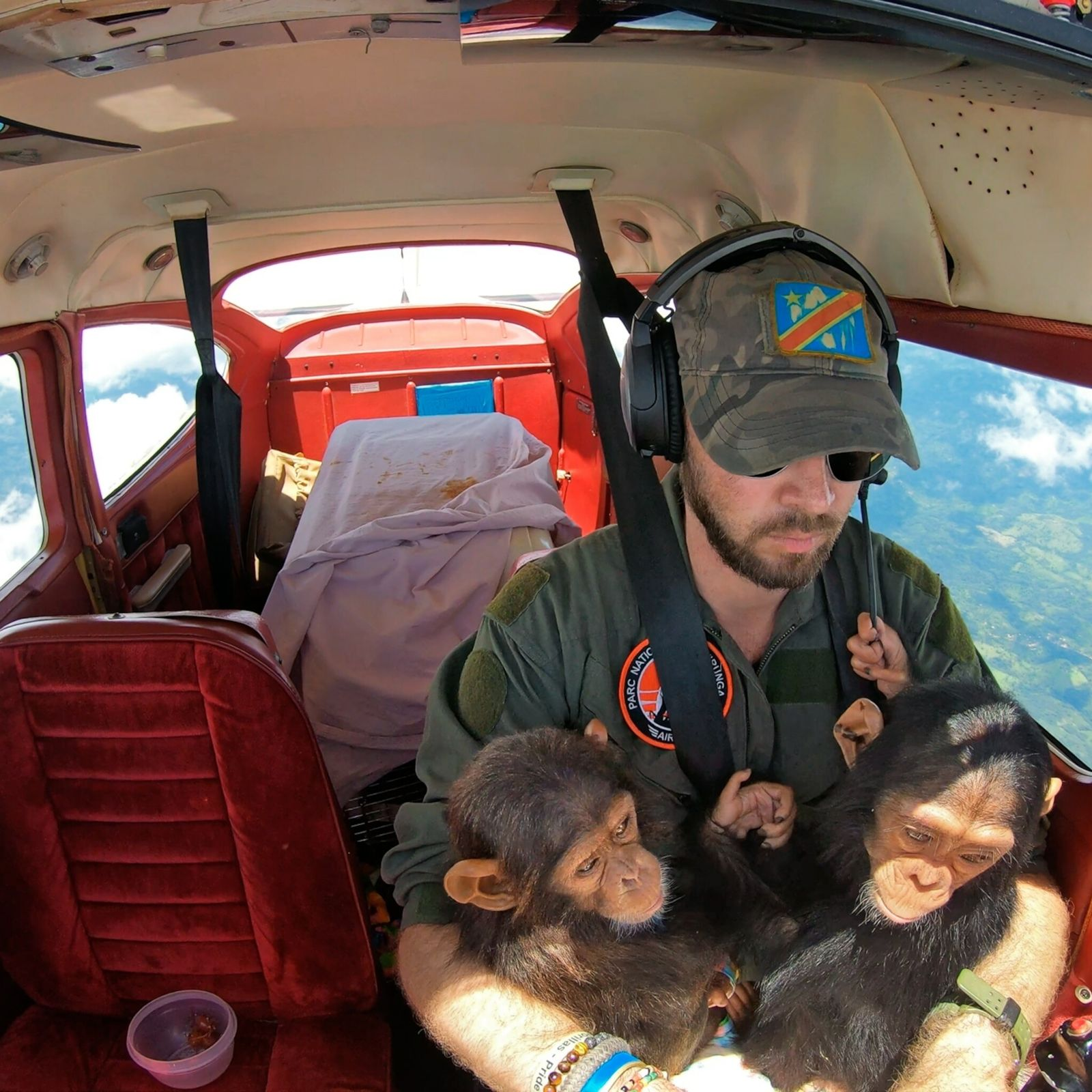 Anthony Caere, a pilot for Virunga National Park in the Democratic Republic of the Congo, cradles ...