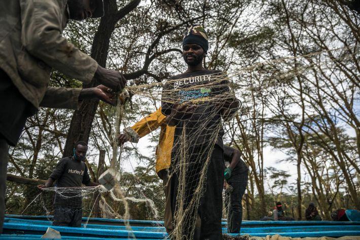 Fishermen untangle their nets at Karagita Beach on Lake Naivasha.