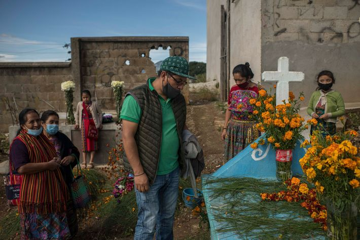In San Juan Comalapa, Leonel Sotz visits the tomb of his father, Basilio Sotz Morales, who ...
