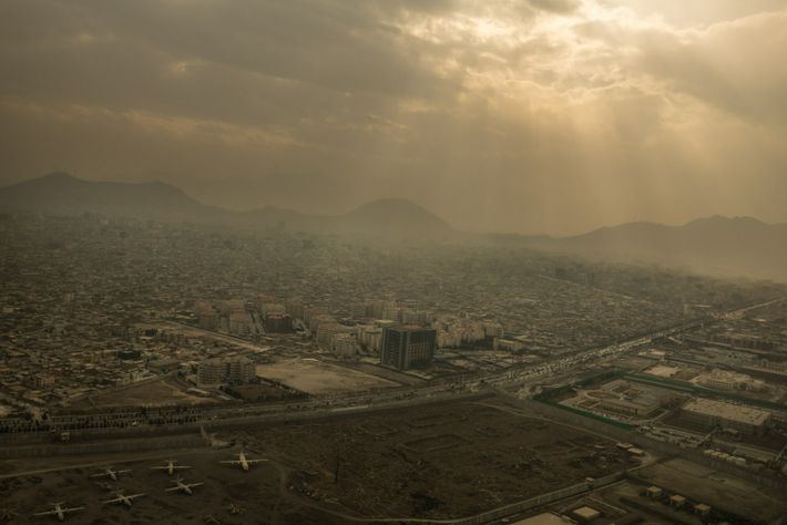 Central Kabul seen from a departing airplane on a winter afternoon. A reconstruction boom fueled by foreign ...