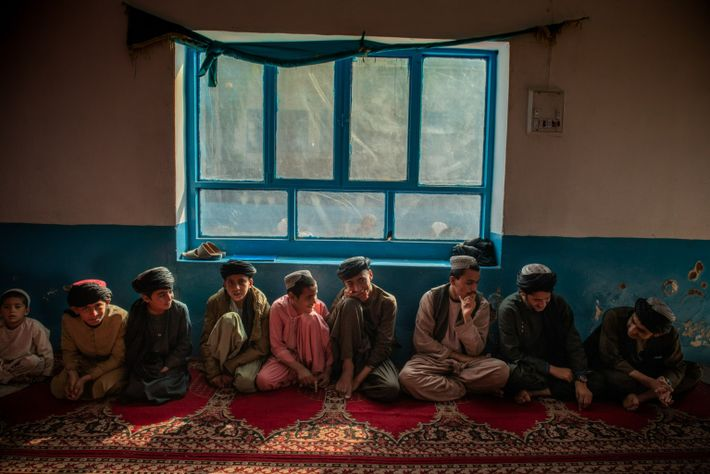 Boys ages 7 to 14 memorize the Quran at a religious school, or madrassa, in Kandahar ...
