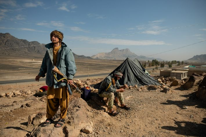 Officer Abdul Ghafoor, 22, stands guard in Panjwai district in March 2021, a strategic spot on ...