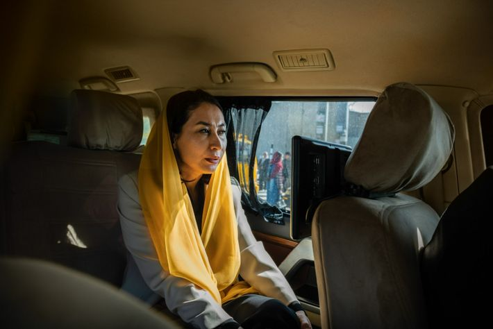Member of Parliament Raihana Azad rides through the streets of Kabul in a bulletproof SUV en route to a legislative session ...